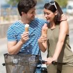 Couple enjoying ice cream cones — Stock Photo #48791113
