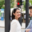 Couple standing chatting in street — Stock Photo #48791539