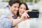 Young couple taking self portrait — Foto Stock