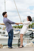 Energetic young couple on a quay — Stock Photo