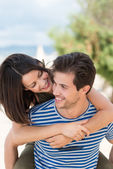 Couple having piggy back ride — Stock Photo