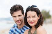 Attractive stylish couple posing outdoors — Stock Photo