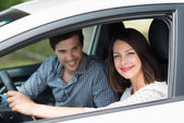 Woman taking her husband for drive — Stock Photo