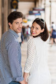 Couple turning to look at camera — Stock Photo