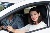 Beautiful competent female driver — Stock Photo