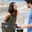 Couple chatting over bicycle — Stock Photo #49041477