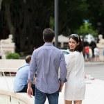 Couple walking past an urban fountain — Stock Photo #49041633