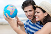 Couple planning their holiday — Stock Photo