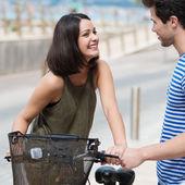 Couple chatting over bicycle — Stock Photo