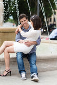 Man holding his girlfriend on lap — Stockfoto