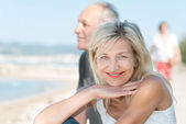 Tanned mature woman at beach — Stock Photo