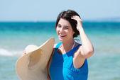 Laughing woman at seaside — Stock Photo