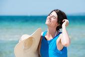 Beautiful woman basking in the sun — Stock Photo