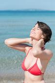 Beautiful woman basking in sunshine — Stock Photo