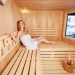 Woman enjoying peaceful sauna — Stock Photo #49840815