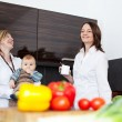 Mothers in kitchen with baby — Stock Photo #49841459