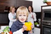 Boy holding yellow capsicum — Stock Photo