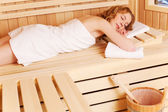 Woman dozing in sauna — Stock Photo