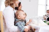Babyboy sitting on mother's laps — Stock Photo