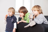 Three children watching television — Stock Photo