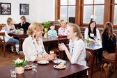Women enjoying refreshments in restaurant — Stock Photo