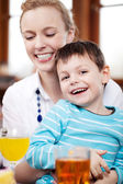 Little boy with mother in restaurant — Stock Photo