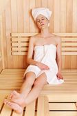 Woman enjoying traditional sauna — Foto Stock