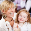 Laughing mother with beautiful daughter — Stock Photo #50288861