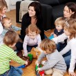 Children playing with mothers — Stock Photo #50288963