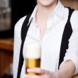 Smiling woman with pint of beer — Stock Photo #50288987