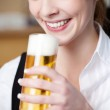 Woman with frothy pint of beer — Stock Photo #50289053