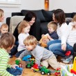 Children playing with mothers — Stock Photo #50289237