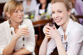 Women socialising as enjoying refreshments — Stock Photo