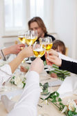 Hands toasting wineglasses — Stock Photo
