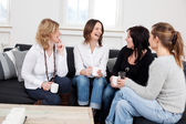 Female friends with coffee cups — Stock Photo