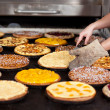 Various pies on oven tray at bakery — Stock Photo #50587447