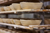 Bread forms in bakery kitchen — Stock Photo