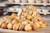 Various breads displayed on table — Stock Photo