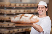 Male worker at bakery — Stock fotografie