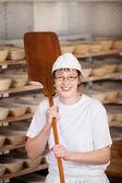 Female chef in bakery — Stockfoto