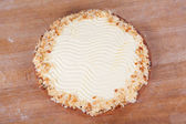 Cream pie on wooden table at bakery — Stock Photo