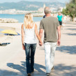 Couple walking on seafront promenade — Stock Photo #50972067