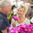 Charismatic woman holding flowers — Stock Photo #50972307
