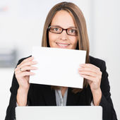 Businesswoman with blank white sign — Stock Photo