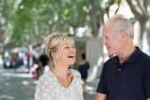 Couple enjoying laugh in street — Stock Photo
