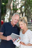Couple checking information on tablet-pc — 图库照片