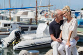 Affectionate couple relaxing in harbour — Stock Photo