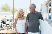 Middle-aged couple going surfing — Stock Photo