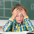 Boy concentrating on his schoolwork — Stock Photo #51324185