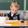Little boy doing artwork at school — Stockfoto #51324263